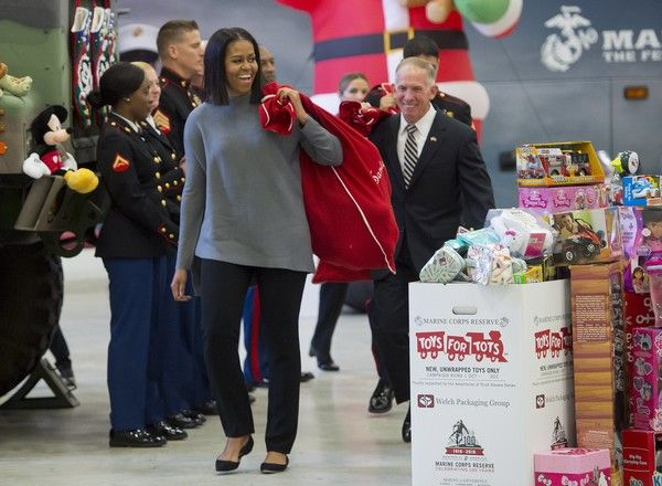 Michelle Obama Photos - US First Lady Michelle Obama helps to sort donated toys for the Marine Corps Reserve Toys for Tots Campaign at Joint Base Anacostia-Bolling in Washington, DC, December 7, 2016. / AFP / SAUL LOEB - Michelle Obama Photos - 156 of 9380