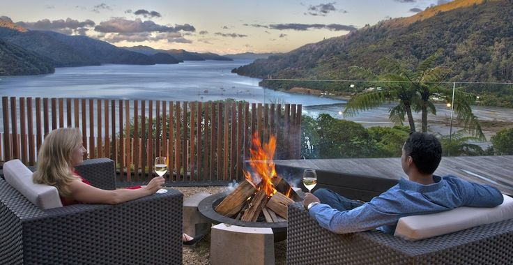 Enjoy a drink by the outdoor fireplace in Marlborough in New Zealand.
