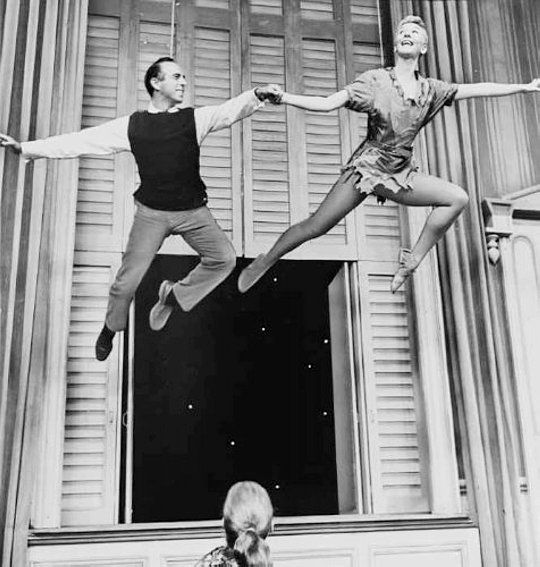 1955 Director and Choreographer Jerome Robbins joins Mary Martin in the air for a publicity photo for NBC's broadcast of the Broadway musical version of 'Peter Pan'.