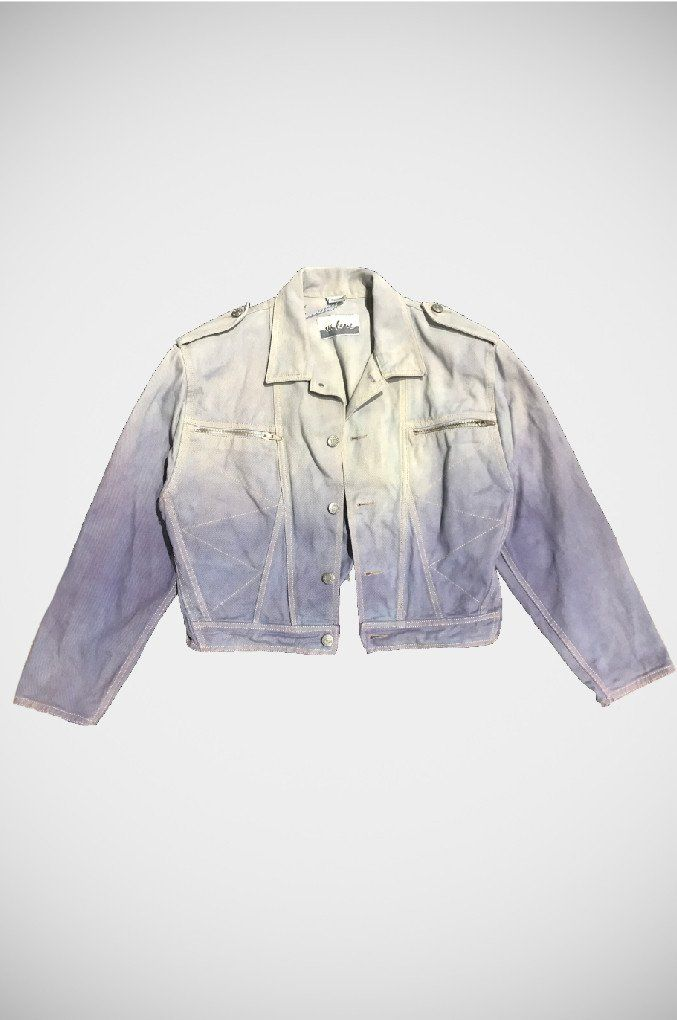 A one of a kind denim jacket! Hand dip died in a blue hue. A vintage cropped moto style jacket with zip detail, this unique piece is definitely a tribute to the 80's.