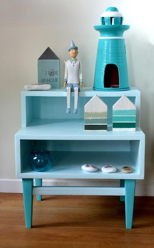 Pinokio and lighthouse on renovated vintage nightstand.