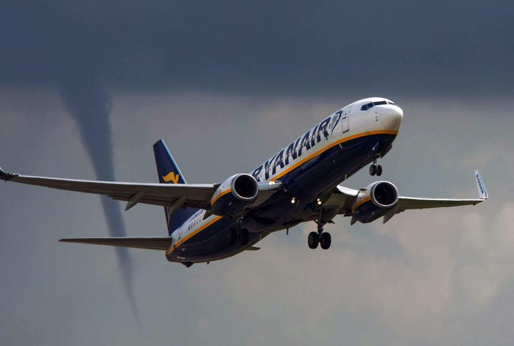 FRIDAY, AUGUST 15: A TORNADO FOLLOWS A PLANE TAKING OFF A tornado follows a Ryanair fight as it takes off at East Midlands airport on route to Palma Mallorca Spain.