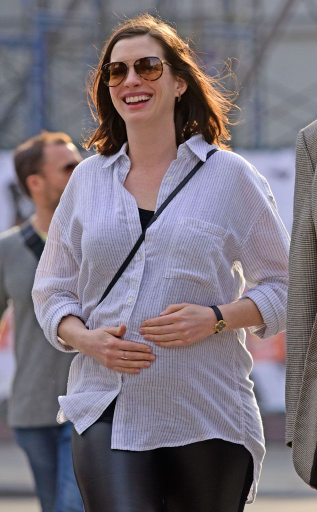 Anne Hathaway Rubs Her Growing Baby Bump in New, Adorable Photos | E! Online Mobile