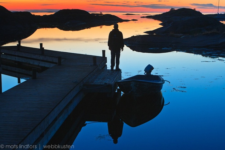 Enjoying the calm summernight in the Stockholm archipelago in Sweden.
