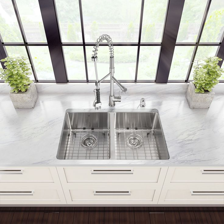 Revitalize the look of your kitchen with a VIGO All in One Kitchen Set featuring a 29-in. Undermount kitchen sink, faucet, soap dispenser, and two sink strainers. The VG2918 Double-Basin Undermount Ki