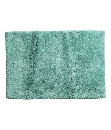 Turquoise. Bath mat in thick cotton terry with tape trim. Non-slip protection at back. Not for use on heated surfaces.