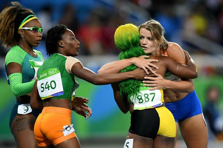 RIO DE JANEIRO, BRAZIL - AUGUST 13: Shelly-Ann Fraser-Pryce of Jamaica is congratulated by Marie-Josee Ta Lou of the Ivory Coast and Dafne Schippers of the Netherlands in the Women's 100m Semi final on Day 8 of the Rio 2016 Olympic Games at the Olympic Stadium on August 13, 2016 in Rio de Janeiro, Brazil. (Photo by Quinn Rooney/Getty Images) — in Rio de Janeiro, Brazil.