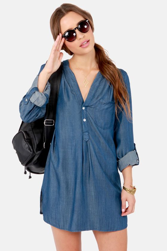 "Bring a breath of fresh air into your wardrobe with the So Fresh and So Jean Denim Shirt Dress and no one will be dressed as cute as you! Soft woven blue twill has a front patch pocket and two shiny shell buttons in front for savvy shirt dress style. A little gathering at the shoulder leads to long sleeves that can be worn down, or rolled up with button-tabs for two lovely looks. Unlined. Model is wearing a size small. Dress measures 2.5"" longer at back. 100% Cotton. Hand Wash Cold."