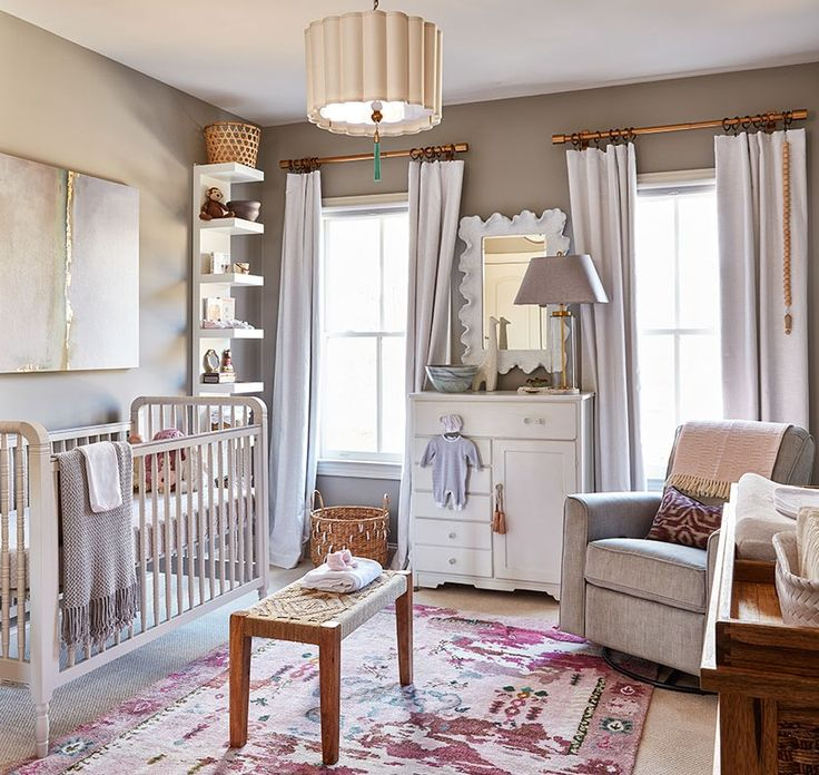 Natalie's soon-to-be newborn Camille's nursery has a bold rug and pink accents