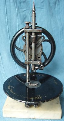 Little Wanzer Serial No. 7763. Dates to 1868. The machine is mounted on a heavy marble slab to provide stability when sewing.