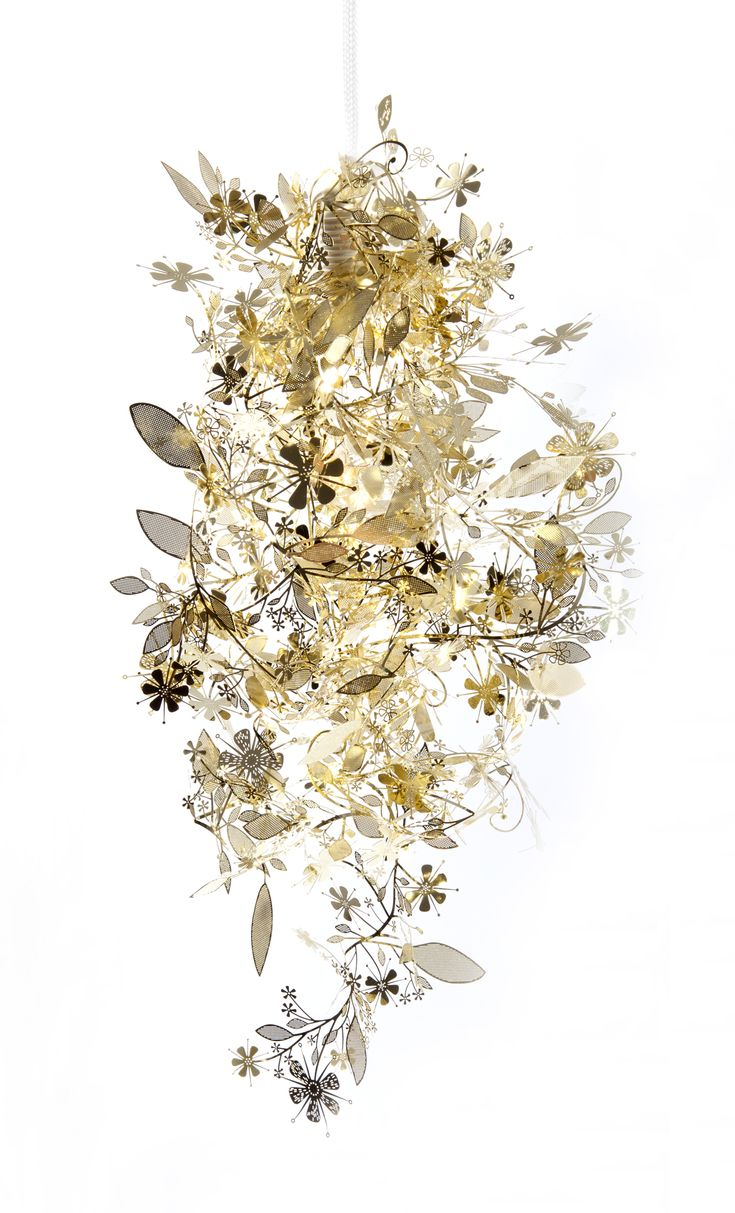 Garland Light Designed by Tord Boontje. You get a flat sheet of intricately-cut laser etched floral garland; separate it into one long strand; drape it around a hanging-bulb. MAGIC. About $99 from any vendor.