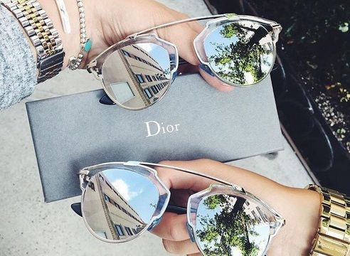 Besties match their Dior So Real sunglasses.