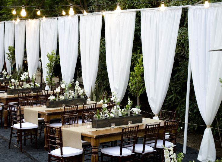 event draping, orchard wedding, wood dining tables, chiavari chairs, string lighting, www.partypleasers.com
