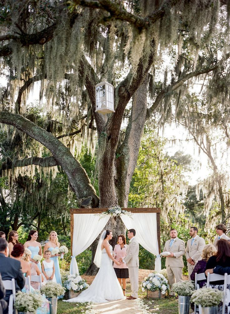 Rustic Outdoor Tampa Wedding Ceremony | Cross Creek Ranch Tampa Wedding Venue | Rustic Outdoor Tampa Weddings with White Draped Altar and White Folding Chairs