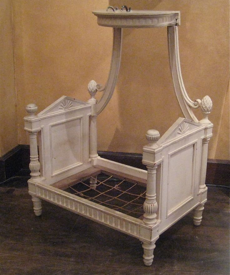 """French Directoire dog bed, circa 1790.  Painted wood.  H: 26″ W: 19″ D: 12 ¾""""  $8,000"""