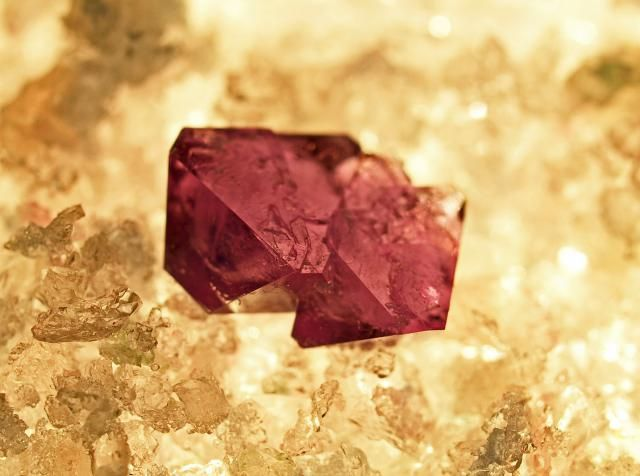 Potassium alum or potash alum crystals grow very quickly and easily. If you color the crystals red you can get beautiful 'ruby' crystals.