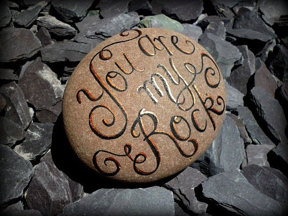 Our pebbles are hand-painted using enamels and metallic paints with a message on each side. This one has You are my Rock on the front, but you
