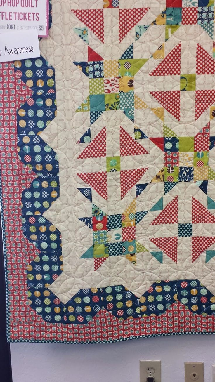I like the border.....looks like squares added to opposite corners.  Quilting Blog - Cactus Needle Quilts, Fabric and More