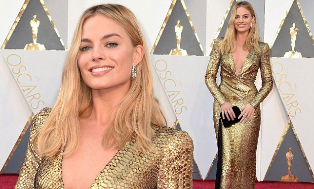 Margot Robbie shows off her cleavage in stunning plunging gold gown