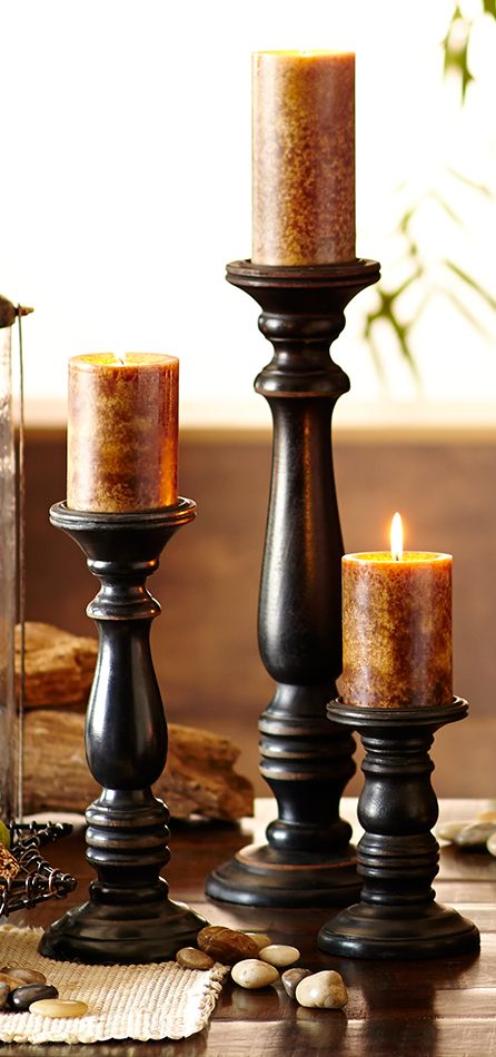 Stagger the heights of your candles with pillar holders to add depth and dimension to your display.