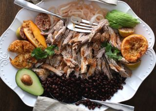 An excellent dish to serve for New Years, when youre tired of traditional American food after all that turkey. This is my most requested recipe. Its easy to prepare, but you need to allow for a long roasting period for the meat to fall apart. The Mojo Criollo (onion/garlic) sauce is served on the side and is a nice accompaniment. Dont skip the marinating procedure for the Mojo sauce - its just not right without it. I like to add the juice of two blood oranges to perk up the color - its ...