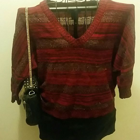Red sweater by Ashley Stewart Red Ashley Stewart size 14/16 sweater with 3/4 sleeve, 22 inches from shoulder to waist. Ashley Stewart Sweaters V-Necks