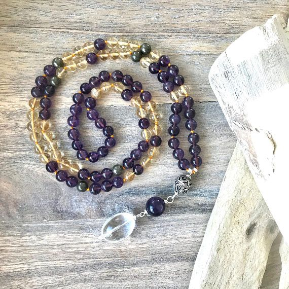 Citrine, Pyrite and Amethyst Mala Bead Necklace. The stones are stunning and radiate joy.   Perfect for your meditation practice or to carry with you to help you with intentions you have set.