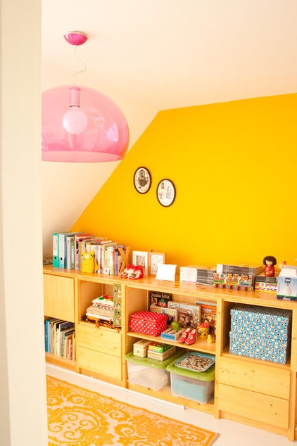 love the yellow wall in this eclectic home office by Planet Fur