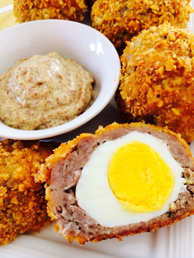 Baked Scotched Eggs - Hard boiled eggs, wrapped in savory sausage with a crispy outer crust. Baked instead of deep fried, no need for the extra grease! DELISH!!