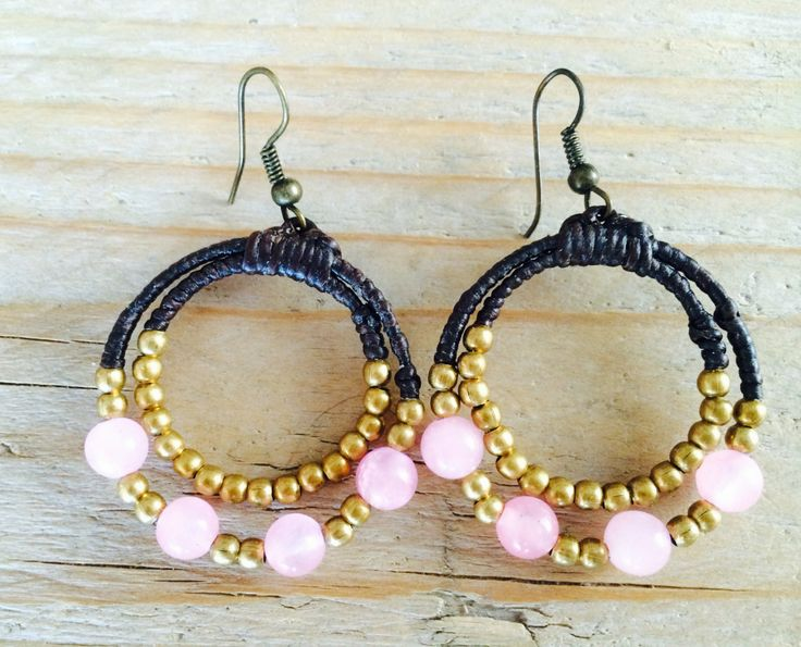 Pink panters, with brown waxed cotton and gold color beads. Save to ware, Nickel and Lead free. €12,50