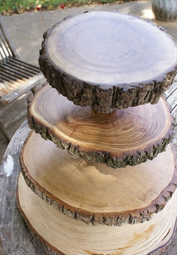 Here's an idea for your cake stand: A four teared cake stand made from different pieces of wood.