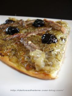 Pissaladière Niçoise / Tarte aux oignons caramélisés, olives noires et anchois. A onion, olive and anchovy tart from Nice, France.
