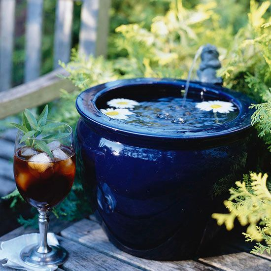 Tabletop Fountain ~ Tabletop Fountain For a simple twist on the traditional outdoor fountain, create a tabletop fountain. This can be easily crafted with a pot and spout for water to trickle from. Here, water bubbles out of a little bronze frog prince into a brilliant cobalt blue pot. Add interest by floating flowers in the basin that move as the water gently flows into the pot.