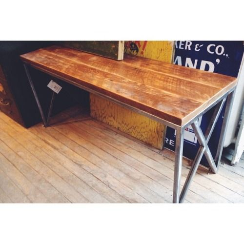 Salvaged solid oak wood from our demolition site. Re-purposed into this lovely bench. On a frame, put together by out welder, using salvaged steel.