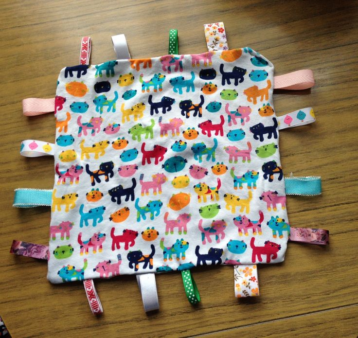 Tag blanket/ comforter with longer tags, made for my god-daughter Tutorial (not mine) here http://www.icanteachmychild.com/make-it-taggie-blanket-for-baby/