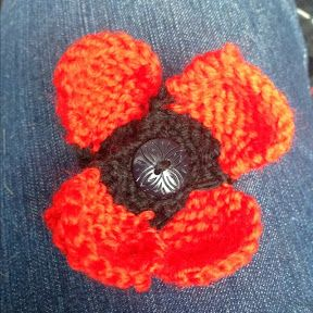 Knitted Poppy Pattern. Inspired by WWI show. Petals are knit separately and then stitched together. From Living with the Knit Guru