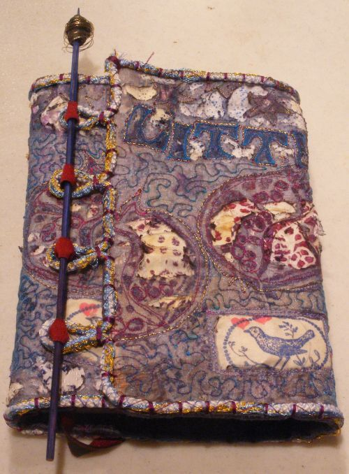new bookwrap mixed media cloth burning embellishment