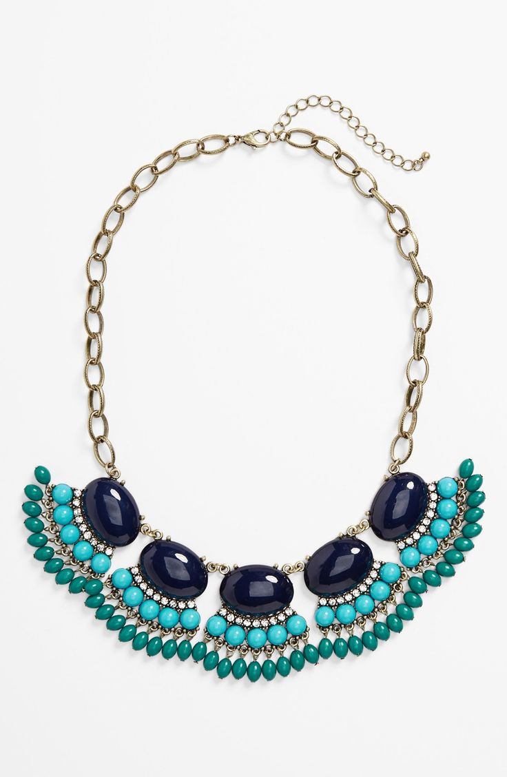 Dressing up a weekend top with this beaded statement necklace.