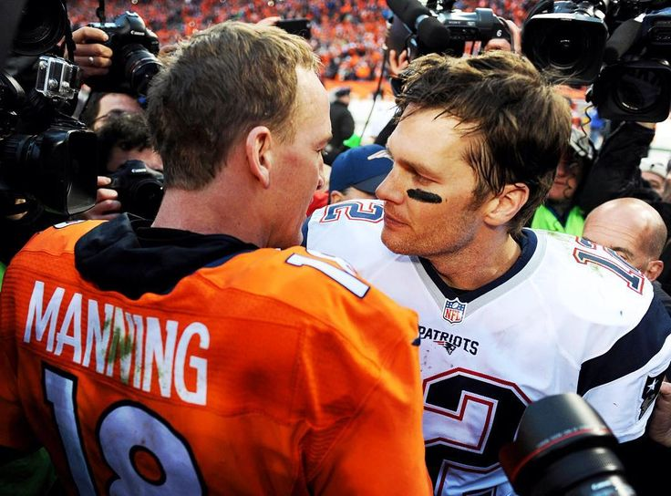 QB Tom Brady #12 of the New England Patriots and QB Peyton Manning #18 of the Denver Broncos exchange words after the AFC Conference Championships.  This was the Patriots' fifth straight conference championship game but, with a final score of 18-20 they were not able to defeat the Broncos.  Photograph by Donald Miralle for Sports Illustrated @donaldmiralle @patriots @nfl #nfl #sportsillustrated