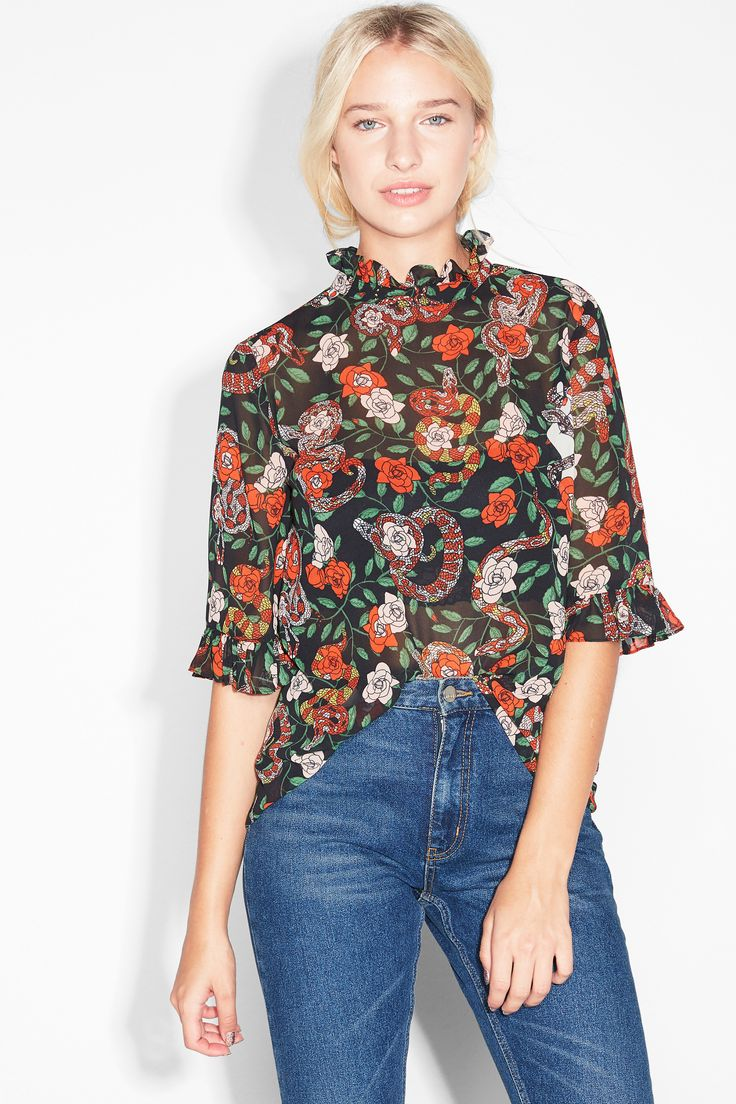 A rather fetching half sleeved blouse with a gorgeous ruffled neckline and cuffs.