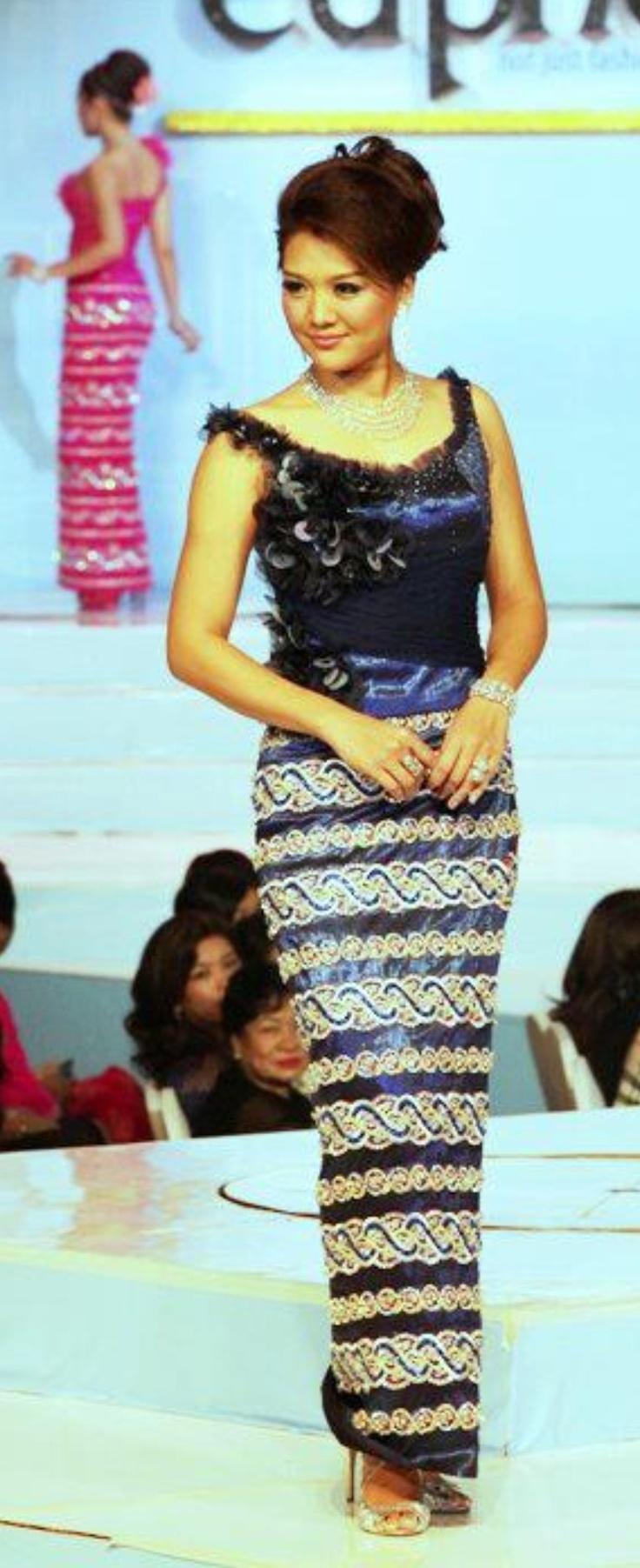 """.A Burmese woman wearing the silk """"acheik"""" longyi."""