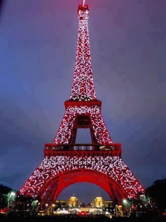red lit effiel tower...I have a  chance of you here next year during the Spring! So excited if we will, literally my life will be complete.  ❤