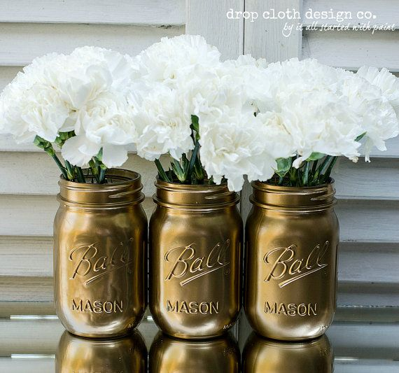 Gold Painted Mason Jar by dropclothdesignco on Etsy, $18.00. So many more on this site as well. Really cute for summer BBQ's!