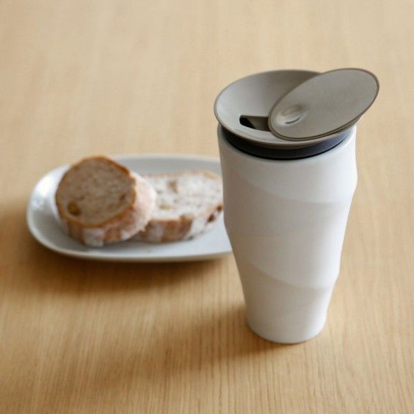This premium coffee mug is a stylish alternative to a typical commuter mug. It is made from double walled porcelain and soft to the touch on the outside.