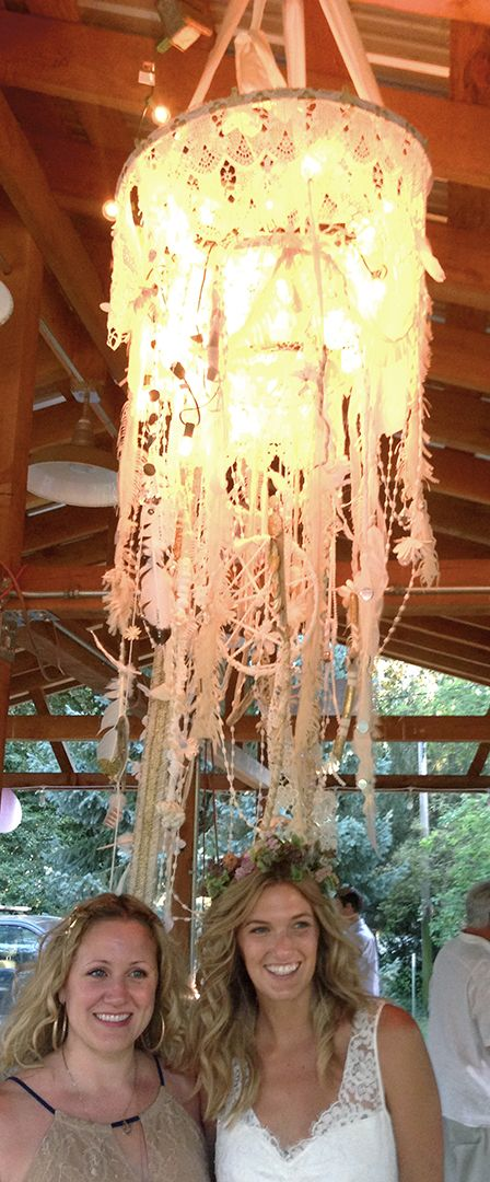 """This was the tendrills from the gorgeous mobile-chandelier handmade at Sarah's coastal bachelorette weekend. It lit up the pavilion in the sweetest way. Driftwood, feathers, dream catchers and handmade lace."""