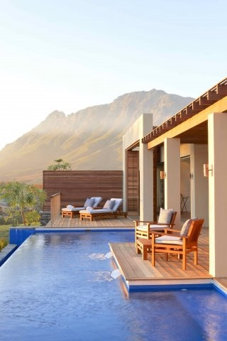 Relais & Chateaux - Perched on the slopes of the magnificent Stellenbosch mountains and surrounded by sweeping views across the estate's vineyards, this prime location provides a sense of escape and privacy. Delaire Graff Estate, South Africa #relasichateaux #pool