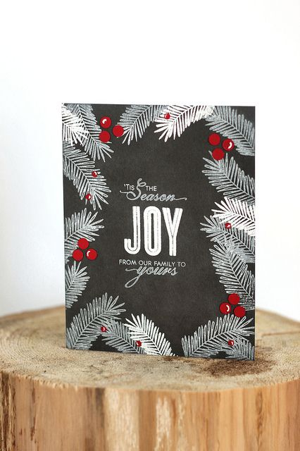 By Elena. Sentiment and fir boughs stamped in white (some boughs heat embossed) on dark gray cardstock.