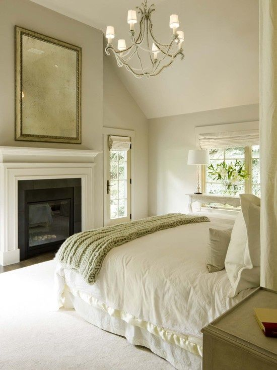 Tranquil Master bedroom. Layers upon layers of neutrals. Love the chandelier- would be great in a dining room too