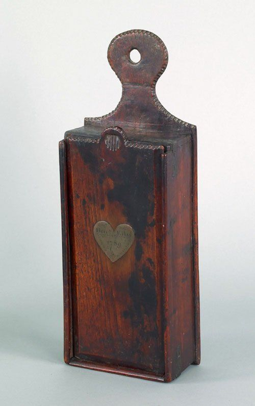New England mahogany candlebox, late 18th c., with lollipop hanger and inlaid heart shaped plaque, inscribed Henry Ellis 1789, 16'' h., 5 3/4'' w.