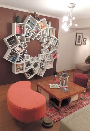 A book shelf out of square boxes arranged in a circle. 3 different sizes